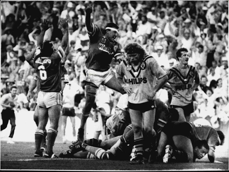 Raiders Chris O'Sullivan (left) and Laurie Daley leap high in exaltation as Balmain's Kevin Hardwick and Michael Neil sink into despair. And John Ferguson is at lower right, sandwiched between giant Paul Sironen and the ground. (Photo by Quentin Jones/Fairfax Media via Getty Images).