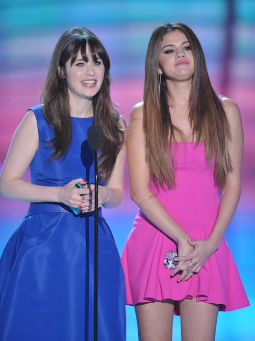 Zooey Deschanel, left, and Selena Gomez speak onstage at the Teen Choice Awards on Sunday, July 22, 2012, in Universal City, Calif. (Photo by John Shearer/Invision/AP)