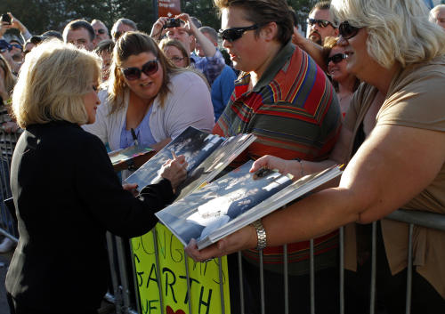 Barbara Mandrell signs an autograph for a fan during her arrival for the Country Music Hall of Fame Inductions on Sunday, Oct. 21, 2012 in Nashville, Tenn. (Photo by Wade Payne/Invision/AP)