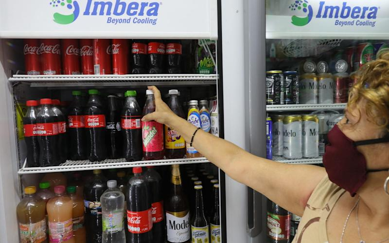The measure puts junk food and sugary drinks on a par with cigarettes and alcohol - Alex Cruz/EPA-EFE