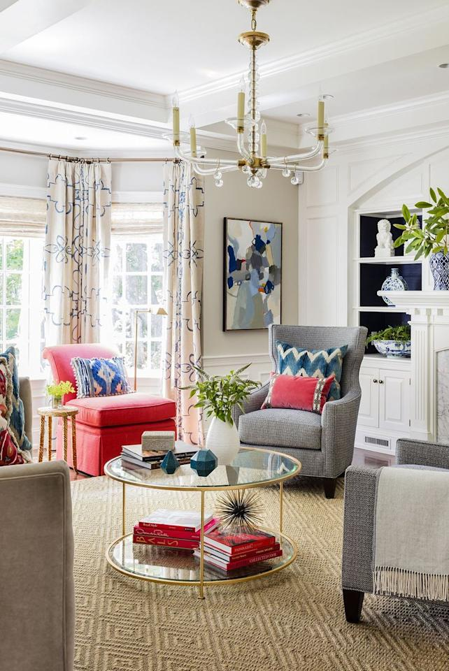 <p>Neutral curtains, featuring a pop of navy blue, elevate this living room. Punches of pink and fresh greenery pull the look together.  </p>