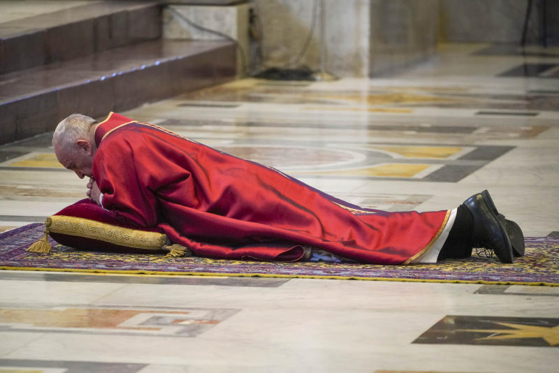 Pope Francis lies down in prayer prior to celebrate Mass for the Passion of Christ, at St. Peter's Basilica, at the Vatican, Friday, April 10, 2020. The new coronavirus causes mild or moderate symptoms for most people, but for some, especially older adults and people with existing health problems, it can cause more severe illness or death. (AP Photo/Andrew Medichini, Pool)