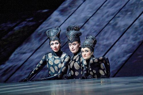 "This Jan. 19, 2012 photo provided by the Metropolitan Opera shows, the Rhinemaidens, from left, Tamara Mumford as Flosshilde, Jennifer Johnson Cano as Wellgunde, and Erin Morley as Woglinde in Wagner's, ""Gotterdammerung"" during a dress rehearsal at the Metropolitan Opera in New York. On May 12 the Met concludes the last of three complete presentations of Robert Lepage's production of the four-opera Ring Cycle, which includes Das Rheingold; Die Walkure; Siegfried and Gotterdammerung. (AP Photo/The Metropolitan Opera, Ken Howard)"