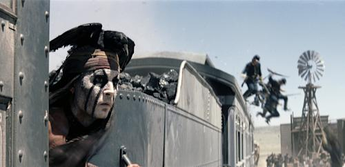 "FILE - This undated file photo provided by Disney shows Johnny Depp as Tonto in a scene from ""The Lone Ranger."" Domestic box office numbers so far on this long Fourth of July holiday weekend are suggesting the highly anticipated, $250 million Western extravaganza is in serious danger of becoming the train wreck of the summer movie season. The animated minions of family favorite ""Despicable Me 2,"" with a price tag one third of what ""The Lone Ranger"" cost to make, is outperforming the masked man by more than three to one. (AP Photo/Disney Enterprises, Inc.)"