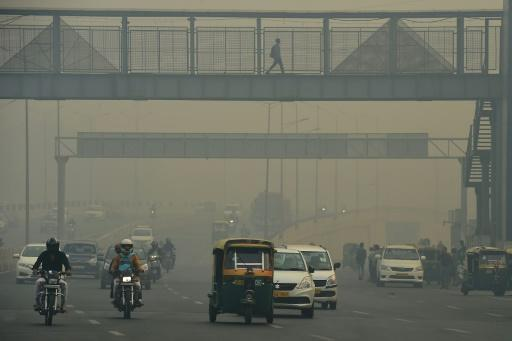 Commuters donned masks in New Delhi as visibility on major roads was reduced to barely 50 metres the morning after Diwali celebrations