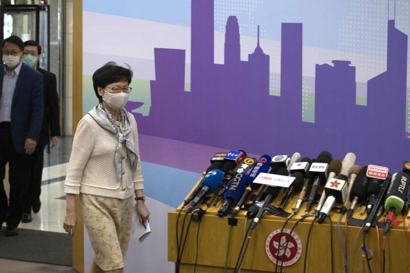 Hong Kong Chief Executive Carrie Lam arrives for a press conference after meeting Chinese leadership in Beijing on Wednesday, June 3, 2020. British Prime Minister Boris Johnson said the United Kingdom stands ready to open the door to almost 3 million Hong Kong citizens, as the city's leader arrived in Beijing on Wednesday for meetings on a planned national security law that has many worried about their future. (AP Photo/Ng Han Guan)
