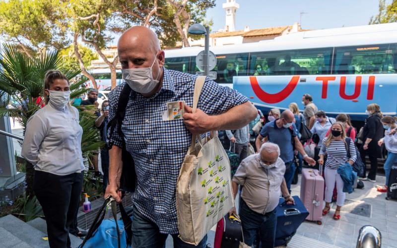 German tourists arrive to Hotel Riu Concordia in Palma de Mallorca, Spain in June 2020 - CATI CLADERA/EPA-EFE/Shutterstock/Shutterstock