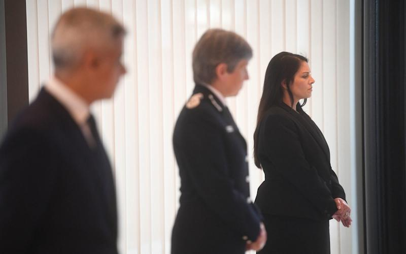 Mayor of London Sadiq Khan, Metropolitan Police Commissioner Cressida Dick and Home Secretary Priti Patel observe a minute's silence inside the atrium at Scotland Yard - Victoria Jones/PA Wire
