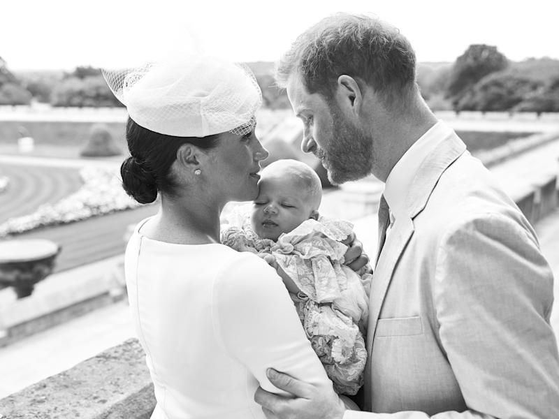"""TOPSHOT - This official handout Christening photograph released by the Duke and Duchess of Sussex shows Britain's Prince Harry, Duke of Sussex (R), and his wife Meghan, Duchess of Sussex holding their baby son, Archie Harrison Mountbatten-Windsor at Windsor Castle with the Rose Garden in the background, west of London on July 6, 2019. - Prince Harry and his wife Meghan had their baby son Archie christened on Saturday at a private ceremony. (Photo by Chris ALLERTON / SUSSEXROYAL / AFP) / XGTY / RESTRICTED TO EDITORIAL USE - MANDATORY CREDIT """"AFP PHOTO / SUSSEXROYAL / CHRIS ALLERTON"""" - NO MARKETING NO ADVERTISING CAMPAIGNS - NO COMMERCIAL USE - NO THIRD PARTY SALES - RESTRICTED TO SUBSCRIPTION USE - NO CROPPING OR MODIFICATION - NOT FOR USE AFTER DECEMBER 31, 2019 - DISTRIBUTED AS A SERVICE TO CLIENTS / (Photo credit should read CHRIS ALLERTON/AFP/Getty Images)"""