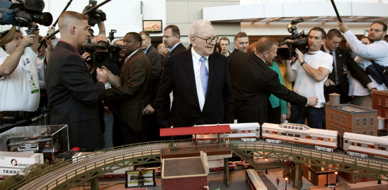 Berkshire Hathaway Chairman and CEO Warren Buffett, center, surveys a model railroad featuring BNSF trains, prior to participating in the annual shareholders meeting, in Omaha, Neb. (AP Photo/Nati Harnik, File)