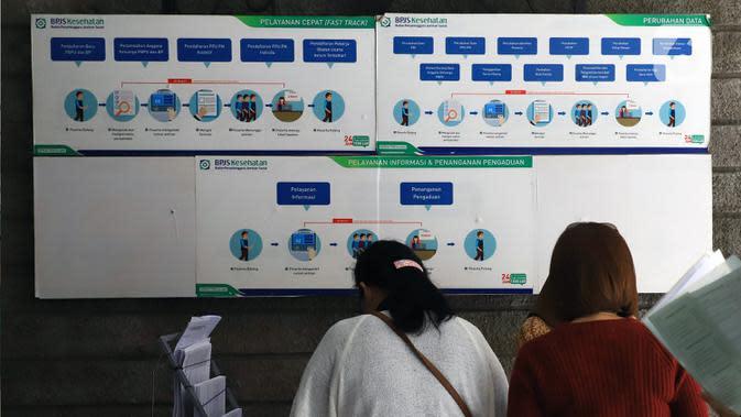 Papan informasi terpampang di Kantor BPJS Kesehatan, Jakarta, Selasa (10/3/2020). Mahkamah Agung (MA) membatalkan kenaikan iuran BPJS Kesehatan setelah mengabulkan sebagian permohonan uji materi terhadap Perpres Nomor 75 Tahun 2019 tentang Jaminan Kesehatan. (Liputan6.com/Angga Yuniar)