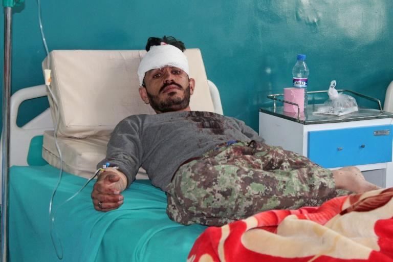 A wounded Afghan National Army soldier rests inside a hospital after an attack a base in Paktia province in May 2020
