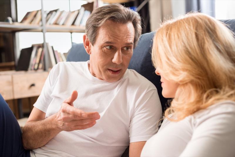 older couple talking, rude behavior