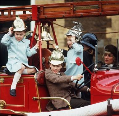 A photo of Princes William and Harry and their mother Diana, Princess of Wales, and their cousins Peter Phillips and Zara Tindall playing on top of a fire engine in the yard of the Old Fire Station in the grounds of Sandringham House in 1988.
