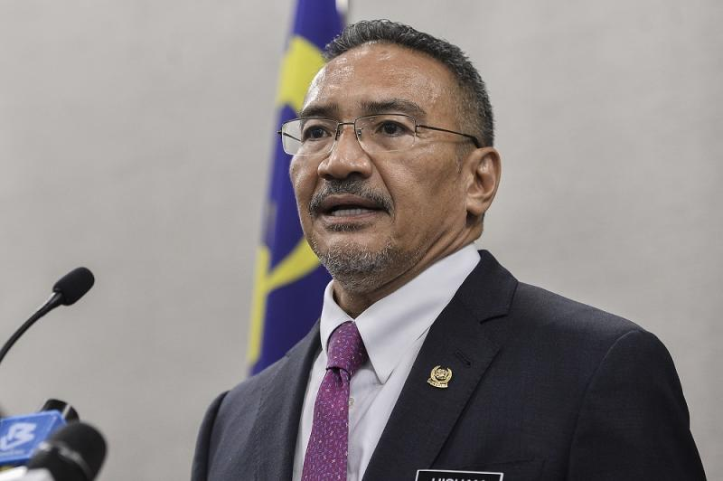 Datuk Seri Hishammuddin Hussein says he will pay the fine, insisting that the law should apply to everybody. ― Picture by Miera Zulyana