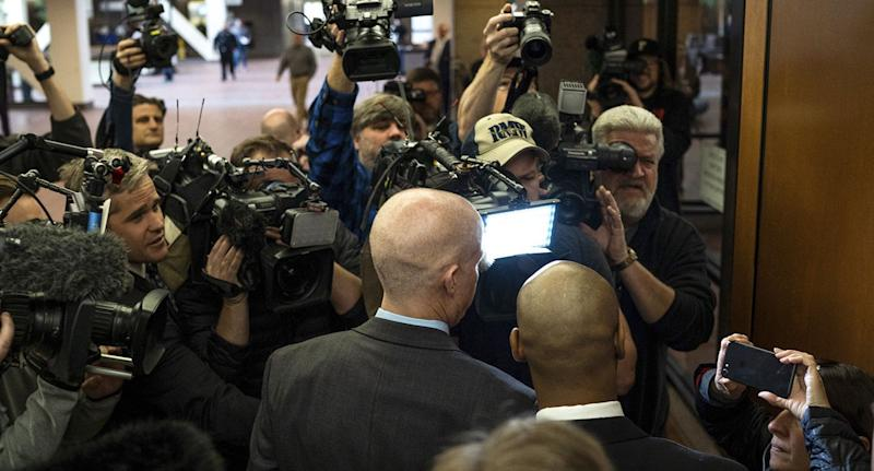 Mr Noor and his attorneys are surrounded by media as they enter the Hennepin County Government Centre in Minneapolis. Source: AAP