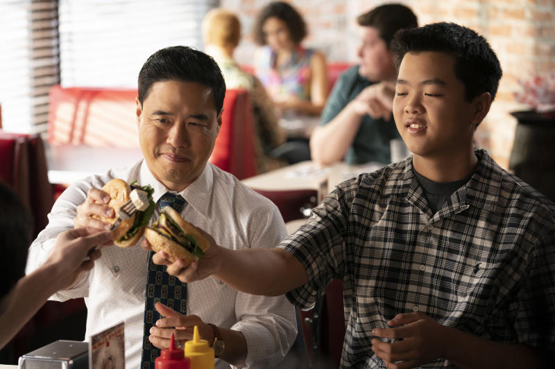 "This undated photo made available by ABC shows Randall Park, left, and Hudson Yang in the Jan. 31, 2020 television episode of ""Fresh Off the Boat."" Inspired by restaurateur and TV personality Eddie Huang's childhood memoir, the sitcom centered on a Taiwanese-Chinese American family living in predominantly white Orlando, Fla., in the '90s. It was the first network TV comedy with an all-Asian cast since Margaret Cho's ""All-American Girl"" premiered 20 years earlier. (Ali Goldstein/ABC via AP)"