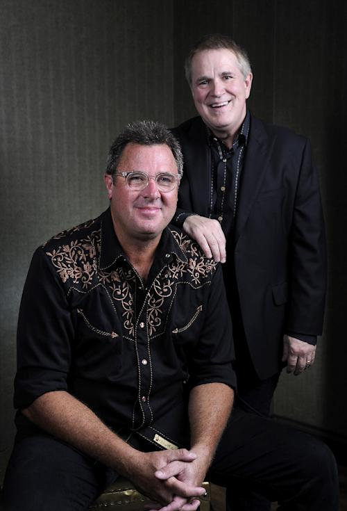 "This Saturday, July 27, 2013 photo shows Vince Gill, left, and Paul Franklin posing at the Grand Ole Opry in Nashville, Tenn. Gill and Franklin released their latest album ""Bakersfield,"" on July 30. (Photo by Donn Jones/Invision/AP)"