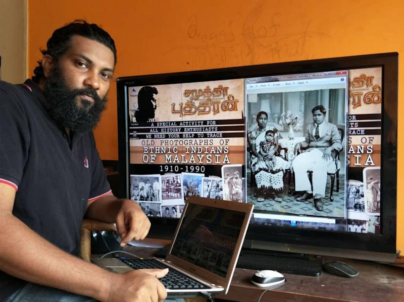 Film director JK Wicky posing with backdrop of an old picture of a family in 1938 and his poster for the initiative. — Picture courtesy of JK Wicky