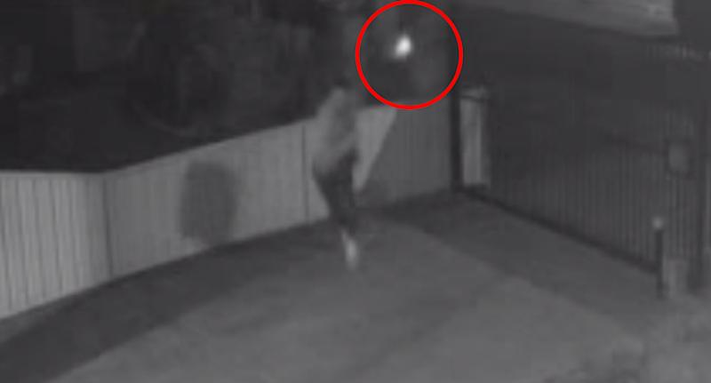 The gunman on June 8 can be seen firing bullets just metres from the target at the Reservoir address.
