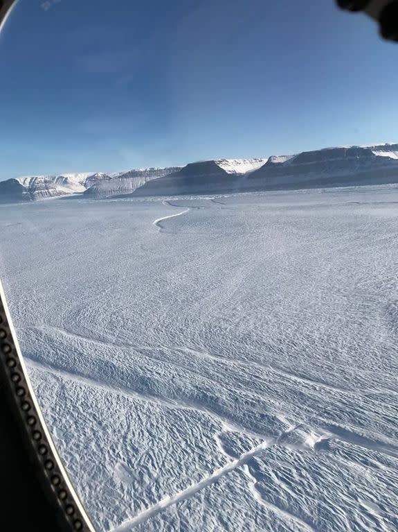 A portion of the new rift on Petermann Glacier's floating ice shelf is shown near the bottom center. The older rift appears near top center. The shaded feature, near the bottom center, is the
