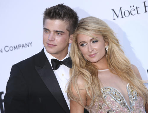 Paris Hilton and River Viiperi arrive at amfAR Cinema Against AIDS benefit at the Hotel du Cap-Eden-Roc, during the 66th international film festival, in Cap d'Antibes, southern France, Thursday, May 23, 2013. (Photo by Joel Ryan/Invision/AP)