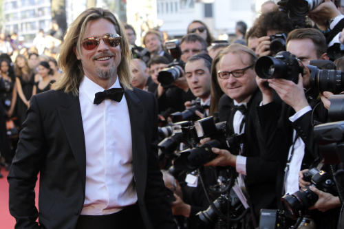 Actor Brad Pitt arrives for the screening of Killing Them Softly at the 65th international film festival, in Cannes, southern France, Tuesday, May 22, 2012. (AP Photo/Francois Mori)