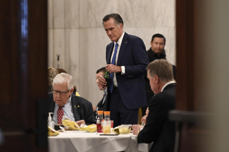 Sen. Mitt Romney, R-Utah, attends a Republican policy lunch on Capitol Hill in Washington, Friday, March 20, 2020, to work on sweeping economic rescue plan amid the pandemic crisis and nationwide shutdown that's hurtling the country toward a likely recession. (AP Photo/Susan Walsh)