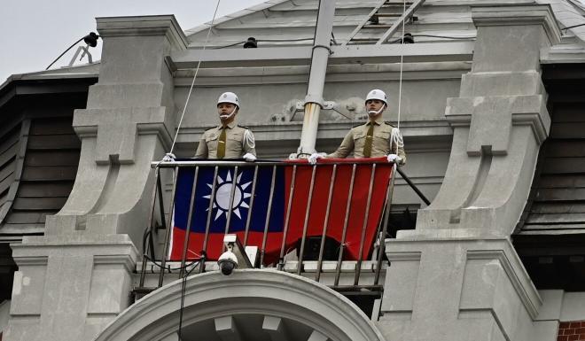 Taiwan's military police prepare to raise the flag. Photo: AFP