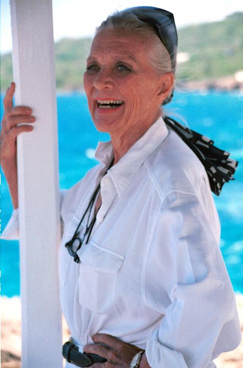 FILE - In this May 27, 2000 file photo, Patrice Wymore, the widow of famed Hollywood star Errol Flynn, is pictured at her home in Port Antonio, Jamaica. The hollywood actress and cattle rancher, has died at her seaside home in northeastern Jamaica. She was 87. (AP Photo/Collin Reid, File)