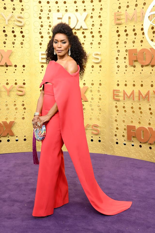 Angela Bassett brought a serious dose of colour to the purple carpet with a bold jumpsuit by Antonio Grimaldi.