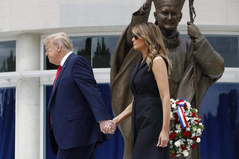 President Donald Trump and first lady Melania Trump depart after visiting Saint John Paul II National Shrine, Tuesday, June 2, 2020, in Washington. (AP Photo/Patrick Semansky)