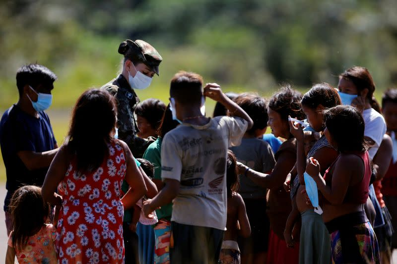 Indigenous people of the Yanomami ethnic group are checked by a medical team of the Brazilian Armed Forces, amid the spread of the coronavirus disease (COVID-19), at the 5th Special Frontier Platoon in the municipality of Auaris