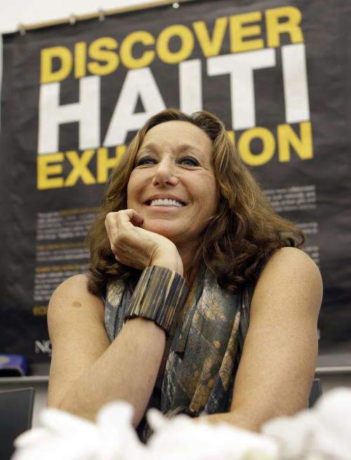 Fashion designer Donna Karan smiles as she talks to guests and visitors at the Little Haiti Cultural Center in Miami, Friday, May 17, 2013. Karan is among the designers and celebrities who have advocated for Haitian artisans since a catastrophic earthquake shook the Caribbean country in 2010. (AP Photo/Alan Diaz)