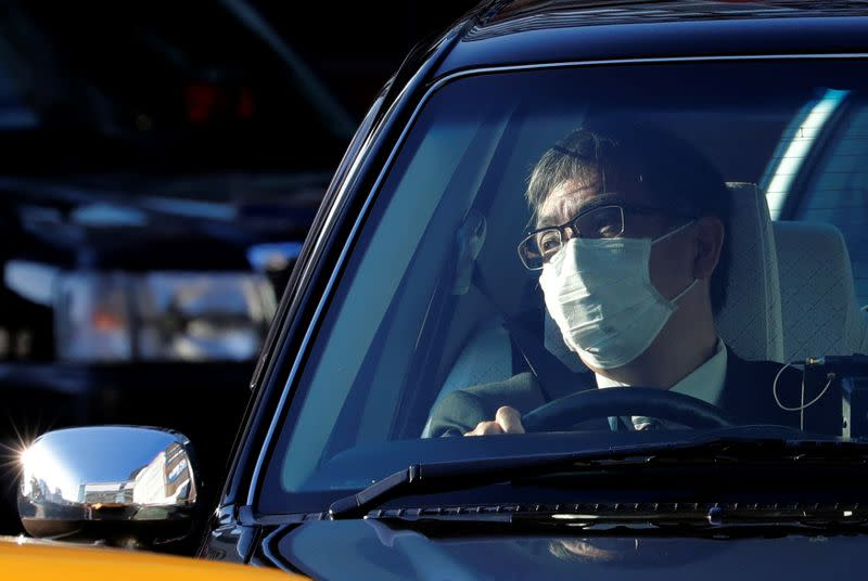 After first death, Japan pledges more containment effort; cases increase