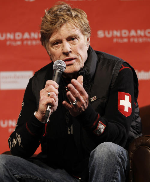 "FILE - In this Jan. 19, 2012 file photo, Sundance Institute president and founder Robert Redford speaks during a press conference at the 2012 Sundance Film Festival in Park City, Utah. Redford is among the 100 celebrities leading ""Artists Against Fracking."" Hydraulic fracturing, a new practice colloquially known as fracking that involves injecting water into underground rock to free vast reserves of gas, has been linked to documented cases of leaking gas ruining nearby well water, of air pollution, and of problems from the waste the drilling generates. (AP Photo/Danny Moloshok, File)"