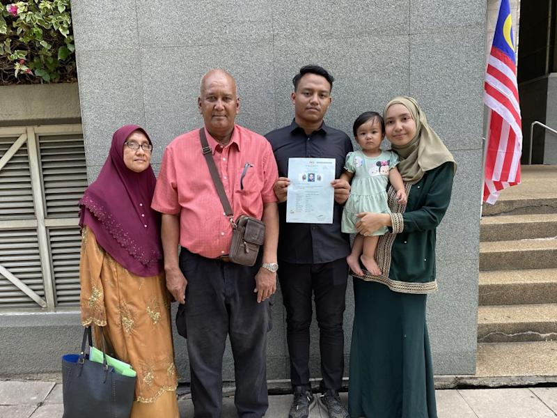 Muhammad Aiman Hafizi Ahmad, 20 (third from left), together with his family after collecting his certificate of citizenship at the National Registration Department in Putrajaya. September 1, 2020. ― Picture courtesy of Lee Yee Woei