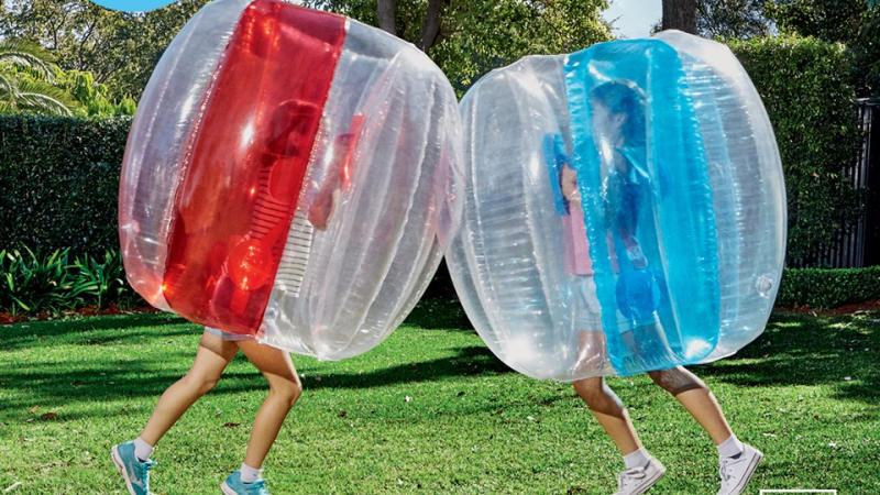 Two children ramming each other inside Aldi's bubble balls. (Image: Aldi Australia)