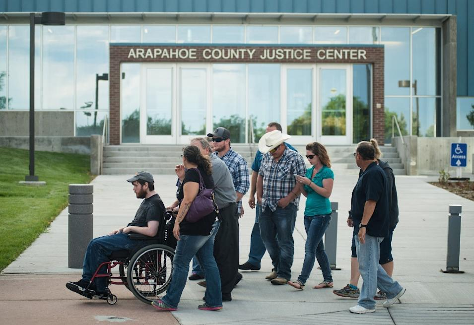 Shooting victim Caleb Medley (L) leaves Arapahoe County Justice Center after a verdict was delivered in the trial of James Holmes on July 16, 2015 in Centennial, Colorado