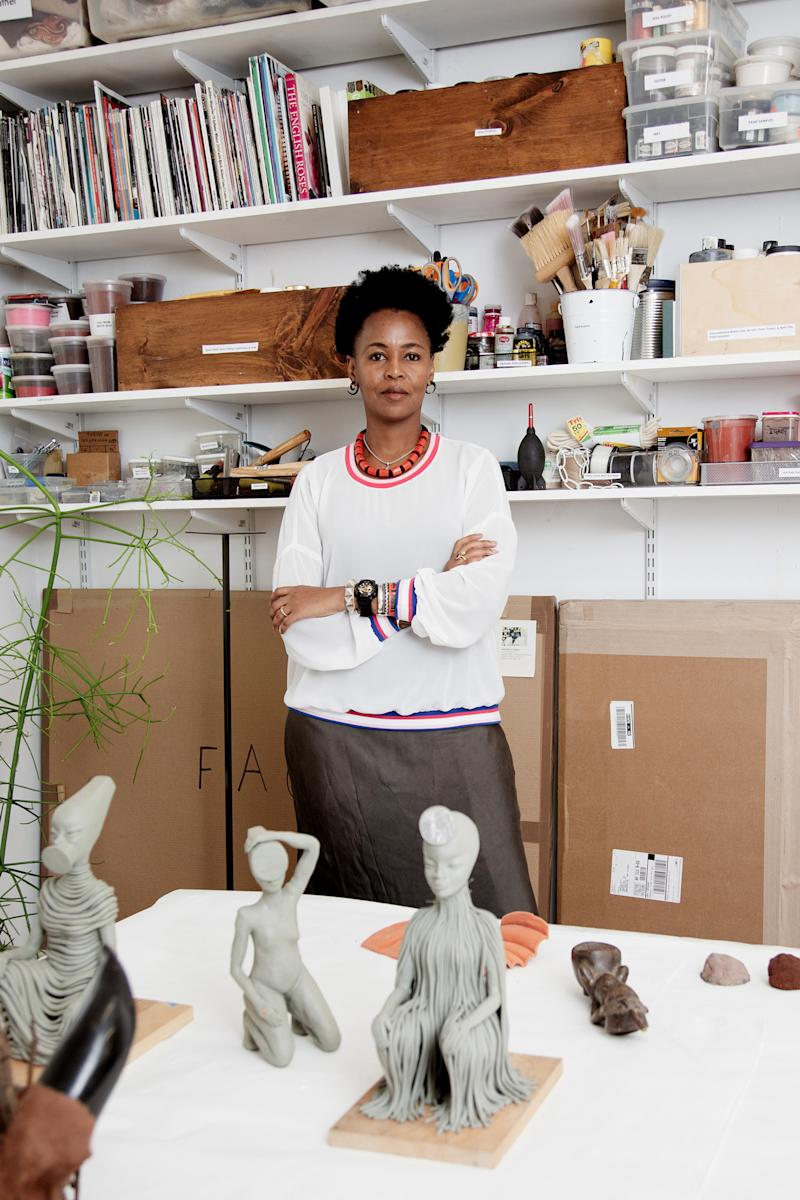 Artist Wangechi Mutu in her Brooklyn studio with models for her sculptures that were installed outside the Metropolitan Museum of Art in New York, Sept. 26, 2019. | Sunny Shokrae—The New York Times/Redux