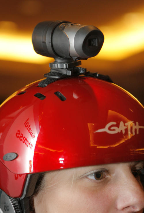 FILE - In this Saturday, Jan. 5, 2008 file photo, Oregon Scientific's ATC 2K Action Cam, a waterproof hands-free video recorder, is mounted on a helmet at the CES Unveiled press preview event held at the Venetian hotel and casino in Las Vegas. For adventure athletes, it's the new essential: a video of their exploits. Now only video action will do for a shoot-it-and-share-it generation of skiers and skydivers, snowboarders and bike riders. (AP Photo/Jae C. Hong, File)