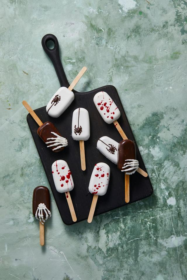 """<p>Cake crumbs mixed with <a href=""""https://www.goodhousekeeping.com/food-recipes/a14630/vanilla-buttercream-recipe-wdy1214/"""" target=""""_blank"""">buttercream frosting</a> and dunked them in melted chocolate is an easy Halloween treat with zero tricks. Promise!</p><p><a href=""""https://www.goodhousekeeping.com/food-recipes/dessert/a33460912/halloween-cake-pops-recipe/"""" target=""""_blank""""></a><em><a href=""""https://www.goodhousekeeping.com/food-recipes/dessert/a33460912/halloween-cake-pops-recipe/"""" target=""""_blank"""">Get the recipe for Halloween Cake Pops »</a></em></p>"""