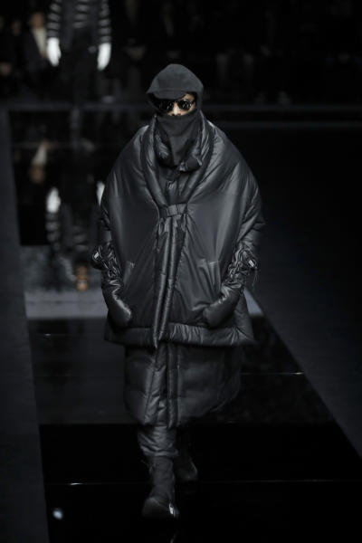 A model wears a creation as part of the Armani men's Fall-Winter 2020/21 collection, that was presented in Milan, Italy, Monday, Jan. 13, 2020. (AP Photo/Luca Bruno)