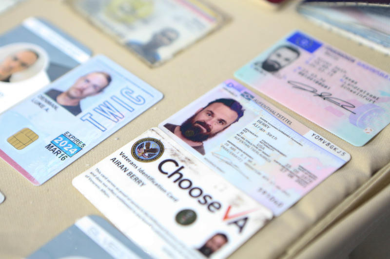 "This photo released by the Venezuelan Miraflores presidential press office shows what Venezuelan authorities identify as the the I.D. cards of former U.S. special forces citizen Airan Berry, right, and Luke Denman, left, in Caracas, Venezuela, Monday, May 4, 2020. Venezuelan authorities say they arrested the two U.S. citizens among a group of ""mercenaries"" on Monday, a day after a beach raid purportedly aimed at capturing Venezuelan President Nicolas Maduro that Venezuelan authorities say they foiled. (Miraflores Palace presidential press office via AP)"
