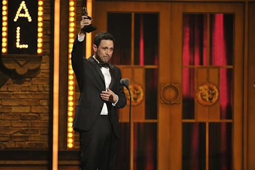 """Steve Kazee accepts the Best Performance by an Actor in a Leading Role award for his performance in """"Once"""" at the 66th Annual Tony Awards on Sunday June 10, 2012, in New York. (Photo by Charles Sykes /Invision/AP)"""