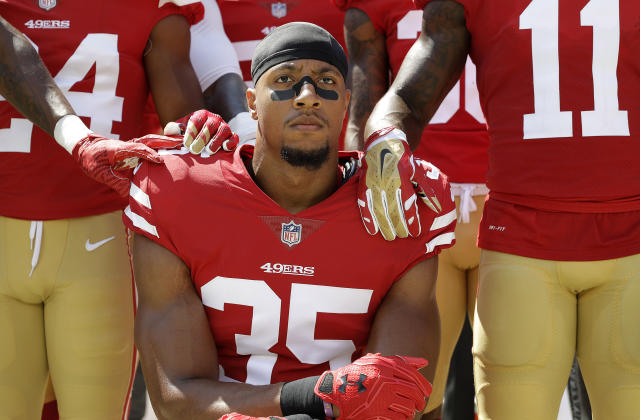 San Francisco 49ers safety Eric Reid kneels in front of teammates during the playing of the national anthem in September. (AP)