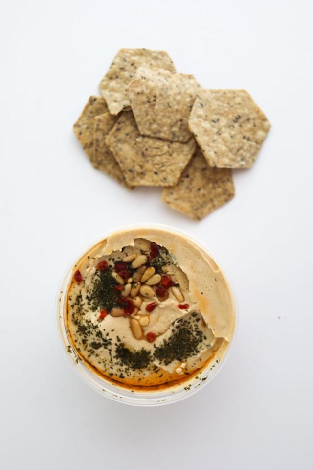 <p>If you weren't sure about the White Bean &amp; Basil Hummus, try out the Trader Joe's Mediterranean Hummus. It's also topped with pine nuts and spices, but the ingredients are slightly different. This one's made with garbanzo beans and doesn't have the basil and olive oil. The Mediterranean Hummus is a bit closer to the original in flavor, but with a prettier presentation.</p>