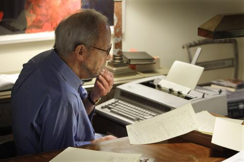 FILE - In this Sept. 28, 2010 file photo, author Elmore Leonard works on a manuscript at his home in Bloomfield Township, Mich. Leonard, a former adman who later in life became one of America's foremost crime writers, has died. He was 87. His researcher says he passed away Tuesday morning, Aug. 20, 2013 from complications from a stroke. (AP Photo/Carlos Osorio)