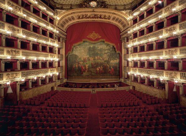"""<p>Having opened in 1737, the <a href=""""https://www.teatrosancarlo.it/en/"""" target=""""_blank"""">Teatro Reale di San Carlo</a> is the oldest continuously active opera house in the world. It was commissioned by the Bourbon King Charles III of Naples and designed by Giovanni Antonio Medrano, a military architect, and Angelo Carasale, the former director of the San Bartolomeo. The horseshoe-shaped auditorium's interior is adorned with neoclassical motifs, including bas relief sculptures throughout. The facade is heavily rusticated on the ground level and features an Ionic colonnade on the second level.</p>"""