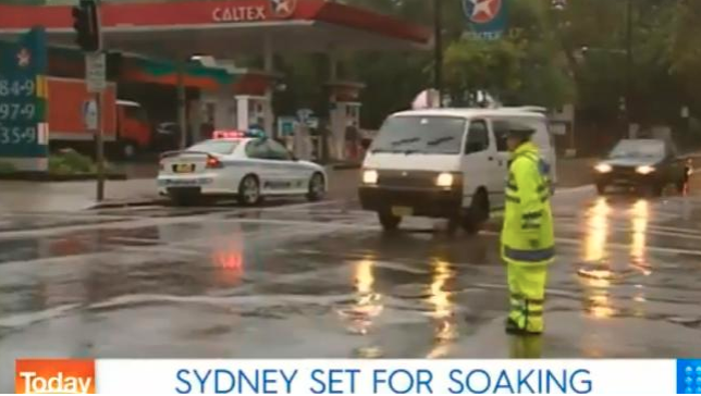 Sydney in 2004 with a police man directing traffic in the rain